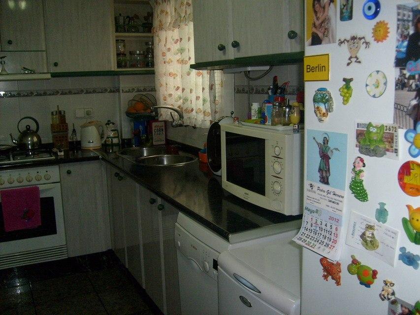Piso-en-venta-acogedor-con-terraza-comunitaria-en-Santa-Rosa-cocina1