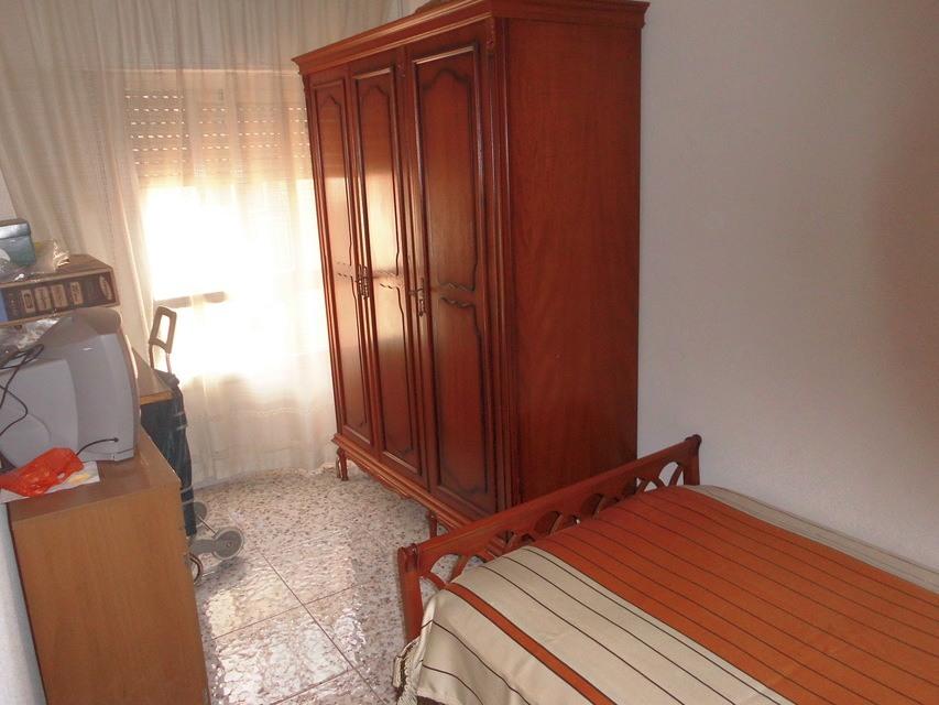 Piso-semireformado-en-venta-con-balcón-exterior-en-Santa-Rosa-habit2