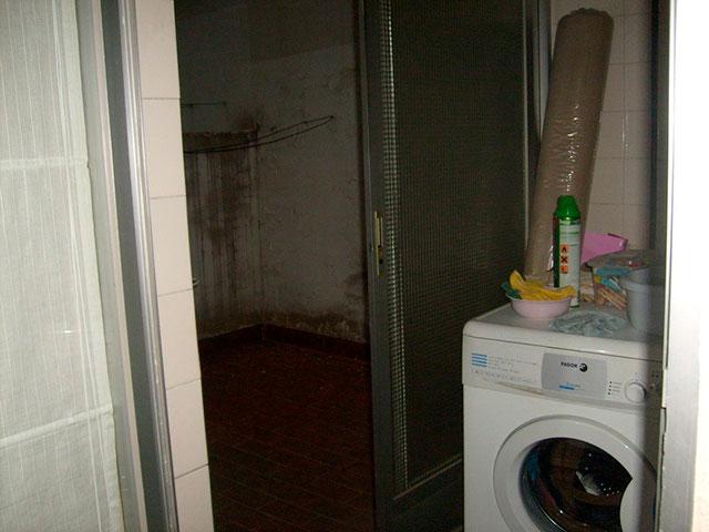 hogar con una gran terraza exterior en ensanche -lavanderia